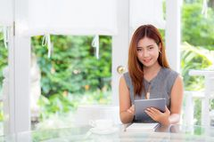 Beautiful businesswoman have enjoyed in the garden with tablet. The beautiful businesswoman have enjoyed in the garden with tablet Royalty Free Stock Photography