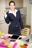 Beautiful businesswoman having breakfast at home Royalty Free Stock Photography