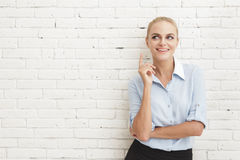 Beautiful businesswoman having a good idea. Portrait of beautiful businesswoman having a good idea with copy space Stock Photos