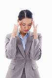 A beautiful businesswoman having a headache Royalty Free Stock Image