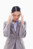 A beautiful businesswoman having a headache Royalty Free Stock Image