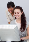 Beautiful businesswoman helping her colleague Stock Photo