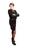 Beautiful businesswoman with her arms crossed. On white background Stock Image