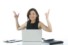 Beautiful businesswoman in her office surprised Stock Photo