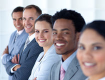 Beautiful businesswoman with her team in a line. Smiling at the camera Royalty Free Stock Photography