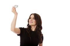 Beautiful businesswoman holding airplane miniature. Stock Photography