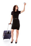 Beautiful businesswoman holding airplane miniature. Royalty Free Stock Image