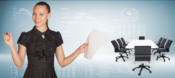 Beautiful businesswoman holding blank paper sheet Stock Image