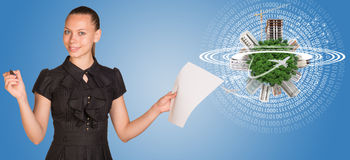 Beautiful businesswoman holding blank paper sheet Royalty Free Stock Photos