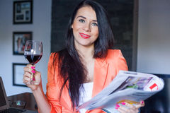 Beautiful businesswoman holding book and wine. Stock Images