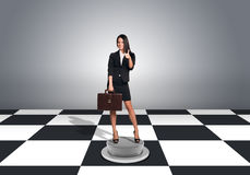 Beautiful businesswoman holding briefcase and Royalty Free Stock Photo