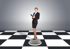 Beautiful businesswoman holding folder Royalty Free Stock Image