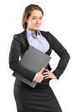 Beautiful businesswoman holding a folder Royalty Free Stock Images