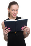 Beautiful businesswoman holding her diary Royalty Free Stock Photos