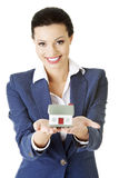 Beautiful businesswoman holding house model Royalty Free Stock Photos