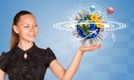 Beautiful businesswoman holding miniature Earth Royalty Free Stock Image