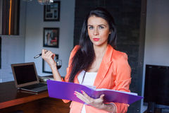 Beautiful businesswoman holding notebook . Royalty Free Stock Photo