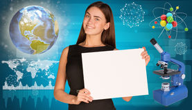 Beautiful businesswoman holding paper holder. Royalty Free Stock Image