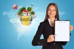 Beautiful businesswoman holding paper holder. Stock Photos