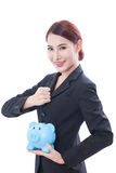 Beautiful businesswoman holding piggy bank stock photo