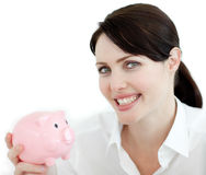 Beautiful businesswoman holding a piggybank. Isolated on a white background Stock Photos