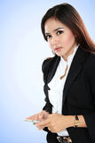 Beautiful businesswoman holding smartphone Stock Image