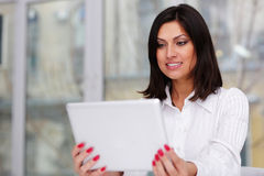 Beautiful businesswoman holding tablet computer Stock Photo