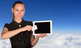 Beautiful businesswoman holding tablet PC and Royalty Free Stock Image