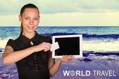 Beautiful businesswoman holding tablet PC and. Beautiful businesswoman holding blank tablet PC and blank business card in front of PC screen. Inscription World Stock Photos