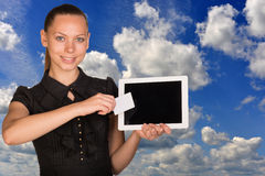 Beautiful businesswoman holding tablet PC. Blue Royalty Free Stock Photos