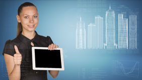 Beautiful businesswoman holding tablet pc. Stock Photo