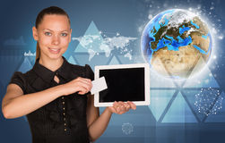 Beautiful businesswoman holding tablet PC. Globe, Royalty Free Stock Photo
