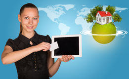 Beautiful businesswoman holding tablet PC. Green Royalty Free Stock Photos