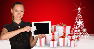Beautiful businesswoman holding tablet PC. New Royalty Free Stock Images