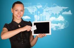 Beautiful businesswoman holding tablet PC. World Stock Photo