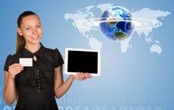 Beautiful businesswoman holding tablet PC. World Stock Image