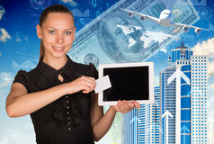 Beautiful businesswoman holding tablet and white Royalty Free Stock Photography