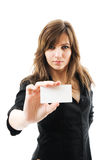 Beautiful businesswoman holding a white card. Portrait of a beautiful businesswoman holding a white card. Isolated Royalty Free Stock Images