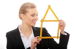 Beautiful businesswoman with house model Royalty Free Stock Image