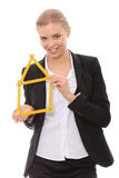Beautiful businesswoman with house model Royalty Free Stock Images
