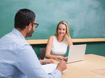 Beautiful businesswoman interviewing man Stock Images