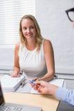 Beautiful businesswoman interviewing man Stock Image