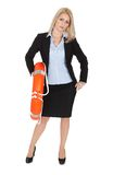 Beautiful businesswoman with life buoy Royalty Free Stock Photography