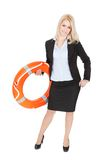 Beautiful businesswoman with life buoy Stock Photos