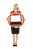 Beautiful businesswoman with life buoy Royalty Free Stock Image