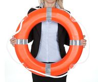 Beautiful businesswoman with life buoy Stock Photo