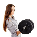 Beautiful businesswoman lifting a dumbell Stock Photo
