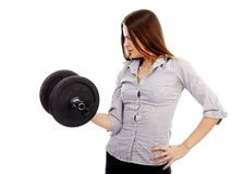 Beautiful businesswoman lifting a dumbell Royalty Free Stock Photography