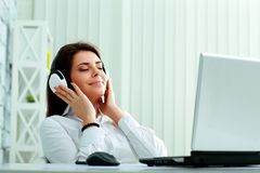 Free Beautiful Businesswoman Listening Music Royalty Free Stock Photography - 35719037