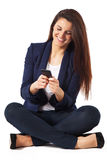 Young business woman sitting by sending a message on white background Stock Photo